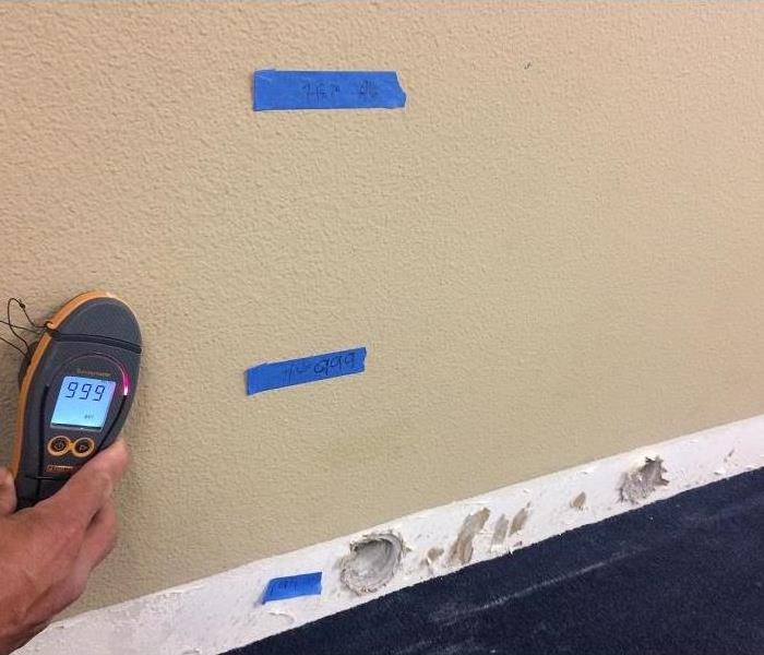 Moisture meter on wet wall