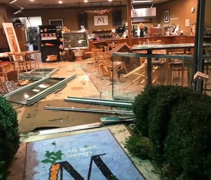 A store is pictured with broken glass and debris throughout