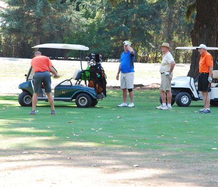 Participants are shown playing golf